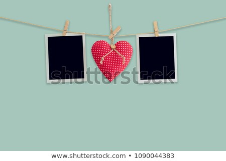 blank instant photo and red heart hanging on the clothesline stock photo © karandaev