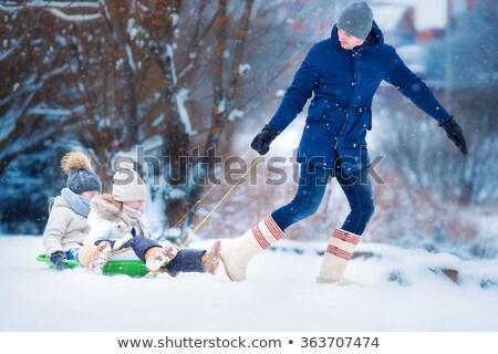Meisje slee gelukkig sneeuw winter grappig Stockfoto © mady70