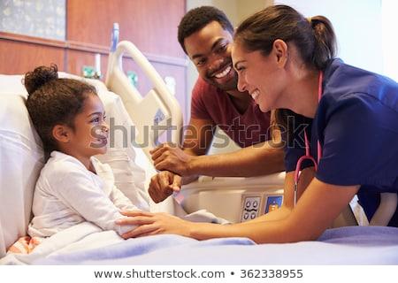 Pielęgniarki atrakcyjny kobieta lekarza szczęśliwy Zdjęcia stock © elvinstar