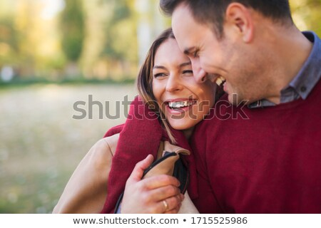 romantic couple holding each other close stock photo © stryjek