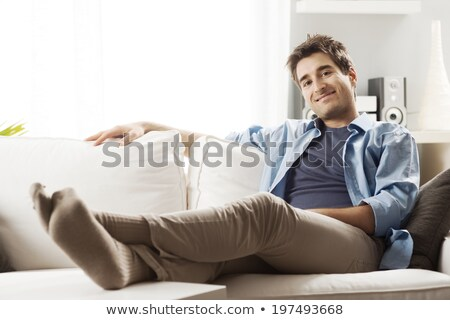young casual man resting and sitting down Stock photo © feedough