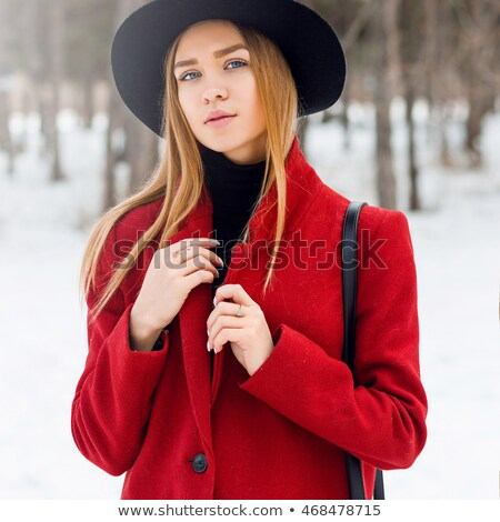 Cute young blond woman in a red and blue outfit Stock photo © dash