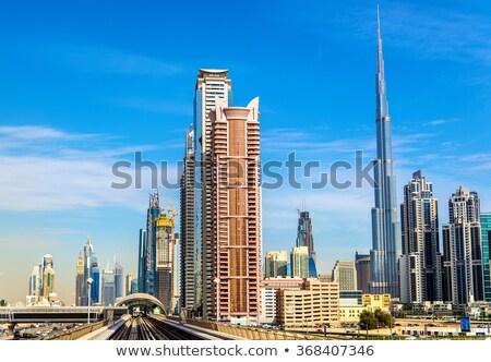 burj khalifa and dubais modern metro station stock photo © anna_om