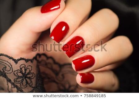 Donna bella rosso mani display Foto d'archivio © juniart