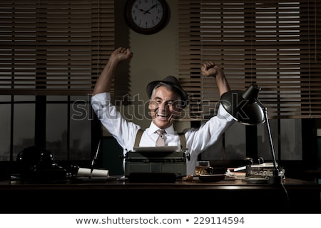 Smiling retro reporter working at office desk Stock photo © stokkete