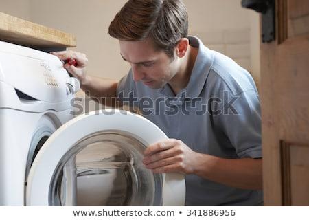 Mérnök házi mosógép férfi boldog konyha Stock fotó © HighwayStarz