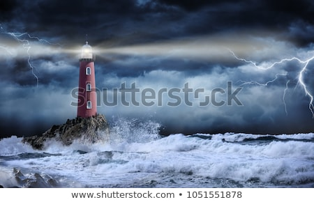 Powerful lighthouse at night Stock photo © smithore