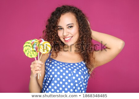 Cute Young Lady and Colored Lollipop Stock photo © fouroaks