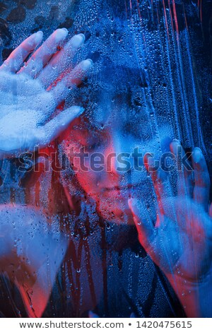 girl behind wet glass stock photo © ajfilgud