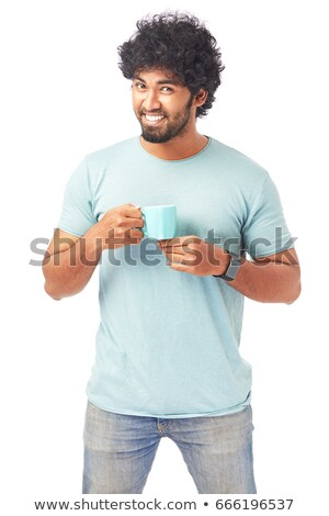 Happy young man with a steamy cup of coffee at home Stock photo © nenetus