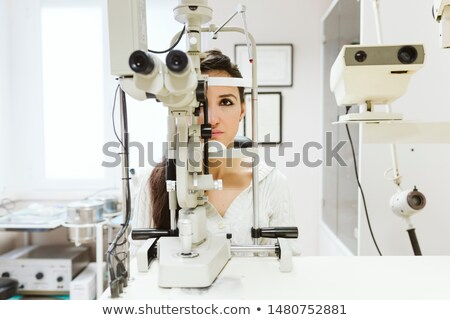 doctor gets measure the pressure to woman patient Stock photo © Flareimage