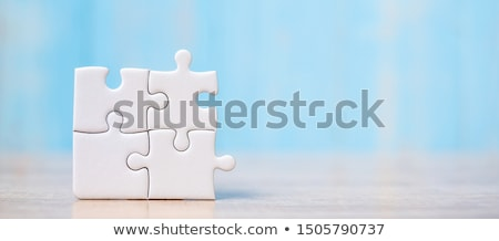 Win - Jigsaw Puzzle with Missing Pieces. Stock photo © tashatuvango