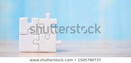 win   jigsaw puzzle with missing pieces stock photo © tashatuvango
