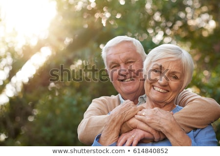 happy elderly couple embraced from behind Stock photo © ambro