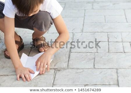 close up of little boy holding toy plane outdoors stock photo © dolgachov