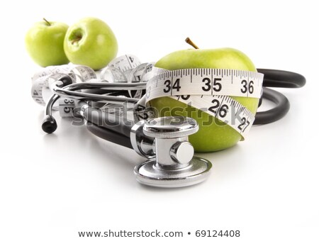Green apple and measuring tape with stethoscope on white  stock photo © Sandralise