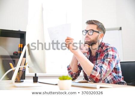 концентрированный человека сидят месте план Сток-фото © deandrobot