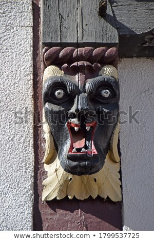 traditional carving at an half timbered house with symbols  Stock photo © meinzahn
