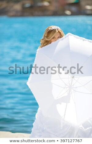 Piękna oblubienicy suknia ślubna ukryty biały parasol Zdjęcia stock © Victoria_Andreas