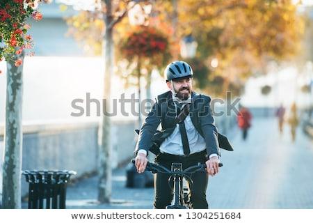 Adam bisiklete binme çalışmak evrak çantası şehir Stok fotoğraf © RAStudio