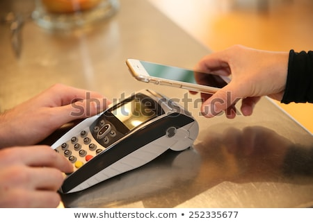 Mobile payment and electronic banking, hand with smartphone Stock photo © stevanovicigor