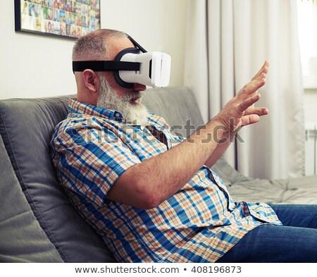 Foto stock: Scared Bearded Man Wearing Virtual Reality Device
