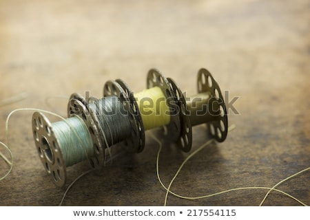 Vintage sewing machine with blue spool thread Stock photo © Aleksangel