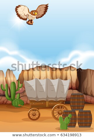 Owl flying over the wagon in desert Stock photo © bluering