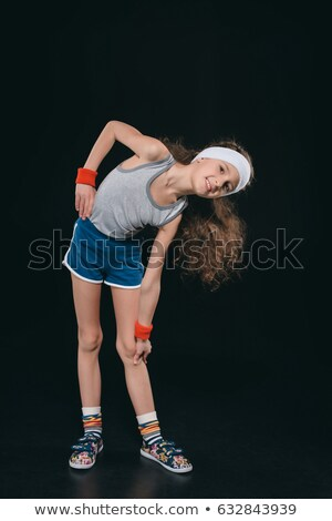 girl in sportswear exercising isolated on black acting kids 11 year old kids concept stock photo © lightfieldstudios