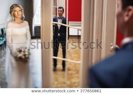 Paar poseren deuropening camera familie meisje Stockfoto © tekso