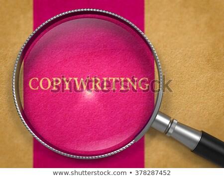 Copywriting through Loupe on Old Paper. Stock photo © tashatuvango
