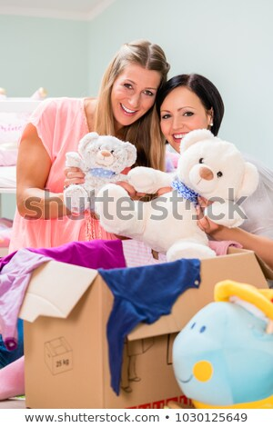 Expectant mother and her friend preparing nursery for baby Stock photo © Kzenon