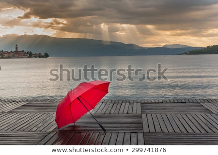 Red umbrella on dock Stock photo © stevanovicigor