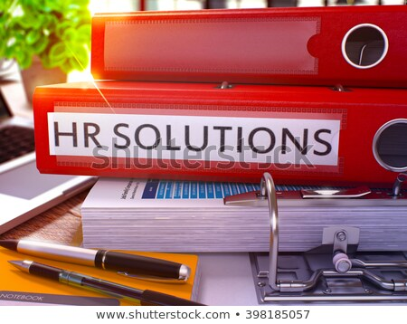 Red Ring Binder with Inscription HR Solutions. Stock photo © tashatuvango