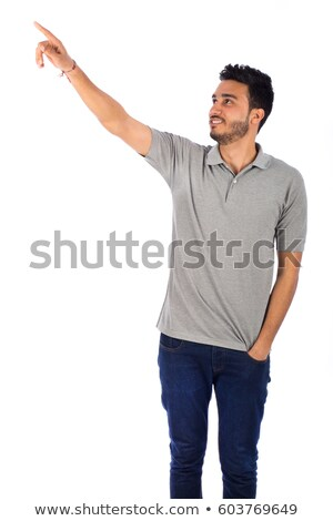 Young muslim man pointing to the side. Stock photo © RAStudio