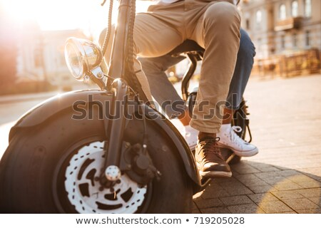 Cropped image of young african couple rides on modern motorbike Stock photo © deandrobot