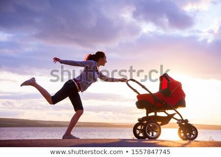 Siluet çalışma anne annelik çocuk Stok fotoğraf © blasbike