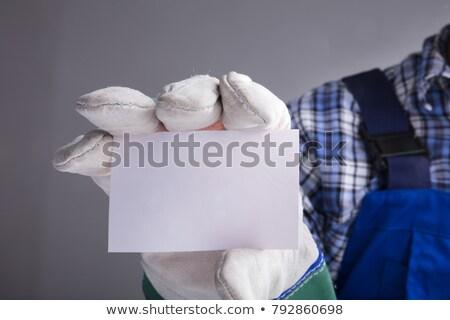 Kezek kesztyű mutat üres kártya közelkép szürke Stock fotó © AndreyPopov