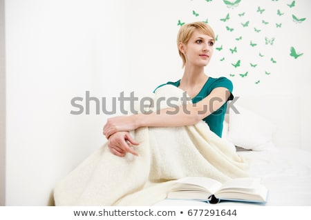 Woman wrapped up on blanket sitting on b Stock photo © IS2