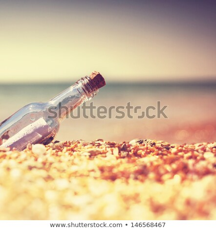 SOS bottle with note, sea Stock photo © rogistok