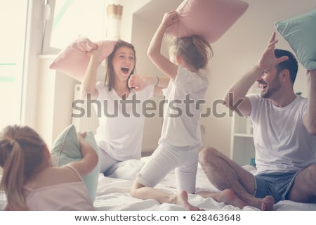 two girls having a pillow fight stock photo © bluering