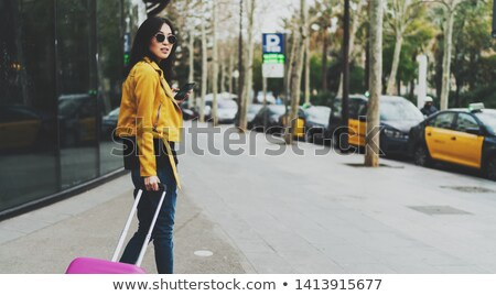 Stock photo: Full length photo of young asian woman with long dark hair holdi