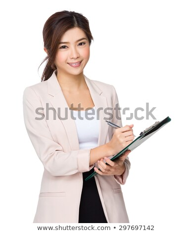 happy young asian businesswoman taking notes stock photo © deandrobot