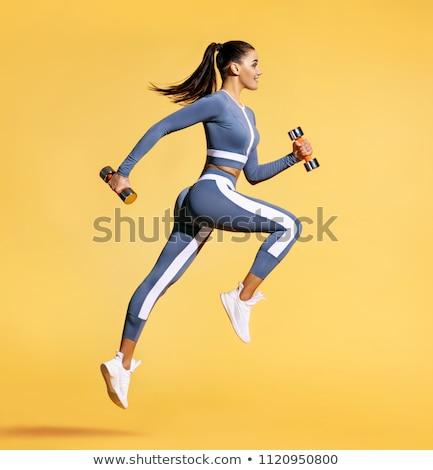 Vista lateral motivado deportes mujer ejercicio banco Foto stock © deandrobot