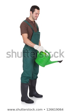 Young cheerful gardener with watering can isolated on white Stock photo © Elnur