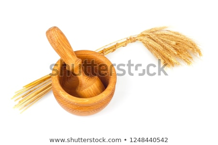 Wooden mortar with pestle and rye ears. Stock photo © brulove