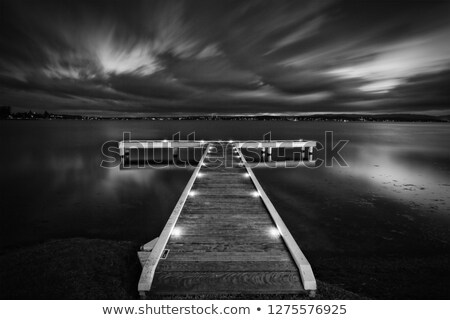 Timber jetty with moody skies at night Stock photo © lovleah