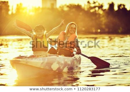 happy family with kid kayaking at tropical ocean Stock photo © galitskaya