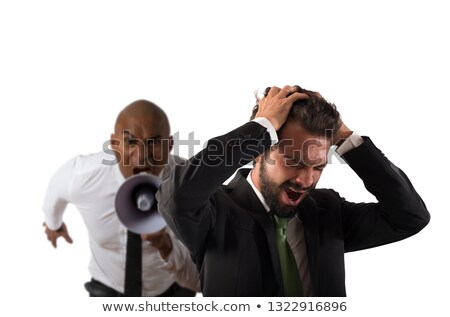 Boss scolds with megaphone a desperate employee with a verbal aggression Stock photo © alphaspirit