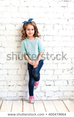 девушки · счастливым · ребенка · белый · кирпичная · стена - Сток-фото © lopolo